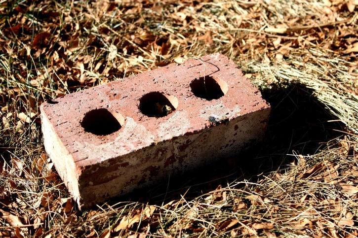 red brick, holes