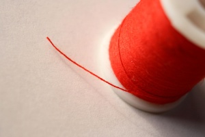 spool, sewing thread, red thread