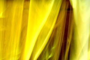 curled glass, yellow glass, close, texture