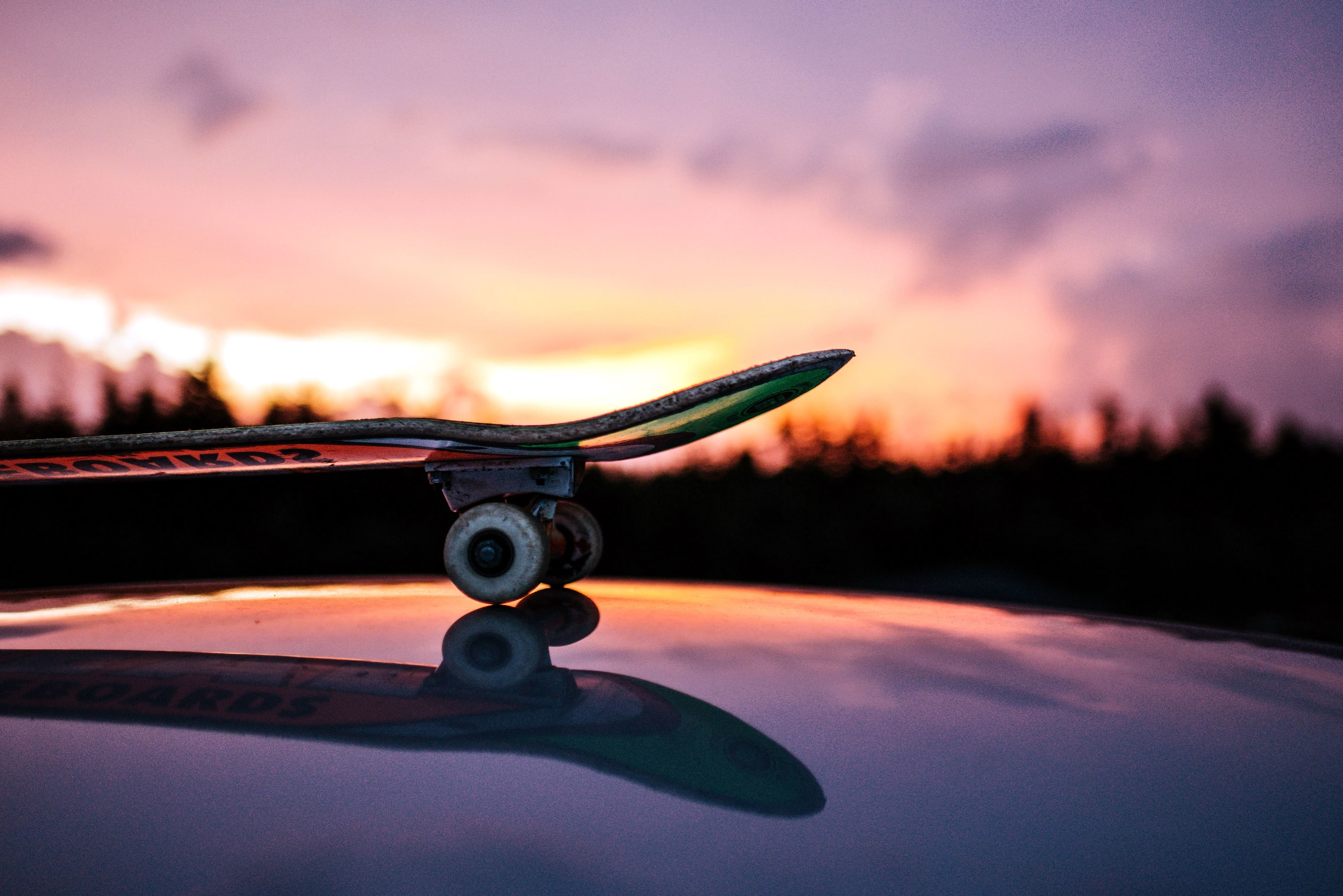 free picture reflection skateboard sky wheels clouds
