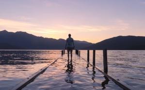 person, dock, nature, sky, walkway, beach, dusk, recreation, reflection, sea