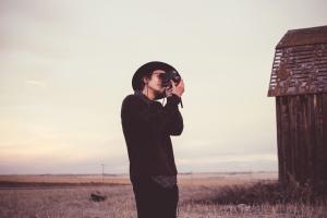 person, taking, photo, barn, field, man