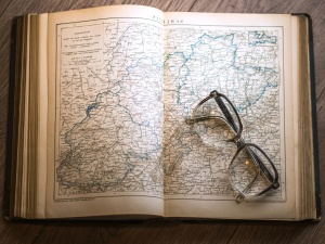 map, paper, table, wood, book, eyeglasses, information