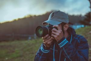 man, sunset, travel, photo camera, photographer, field, grass, hands