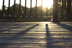 Sun, wooden planks, wooden floor, shadows, railing