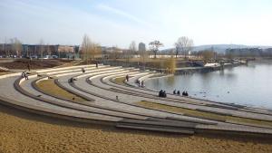 lake, grass, people, platforms, buildings, sky