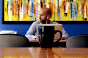 coffee cup, desk, man, mug, table, coffee