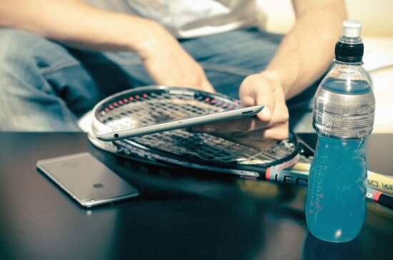bottle, person, smartphone, sport, table, technology