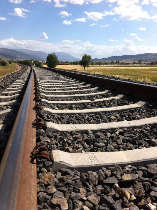 train, transportation, railway, road, rocks, sky, steel, stones