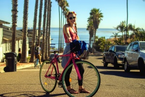 palm trees, girl, road, woman, bicycle, cars, city