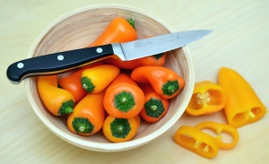 bell pepper, bowl, knife, table, salad