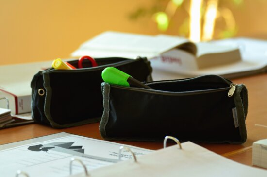 pencil box, pencil, table, books