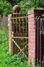 door, metal, brick, plant, fence