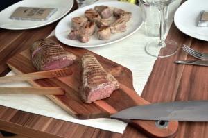 meat, cutting board, knife, food, glass, fork, plate