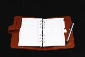 memo pad, leather, metal, pen, address book