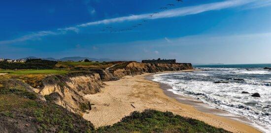 beach, sand, ocean, water, cliff, house, grass
