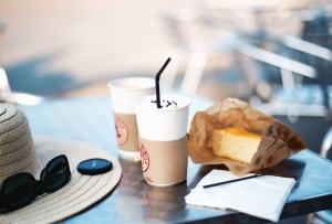 sunglasses, glass, bag, bread, drink, hat, paper