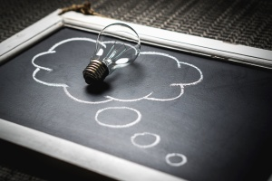 light bulb, blackboard, chalk, idea, metal, glass, electricity