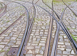 rails, paving stone, intersection, tram, grass, street, city