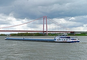 river, bridge, boat, water, vehicle, transport, sky, coast