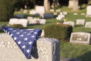 graveyard, cemetery, grave, monument, flag, cemetery, grass, plant, shrub, stone