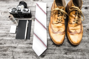 shoe, tie, photo camera, money