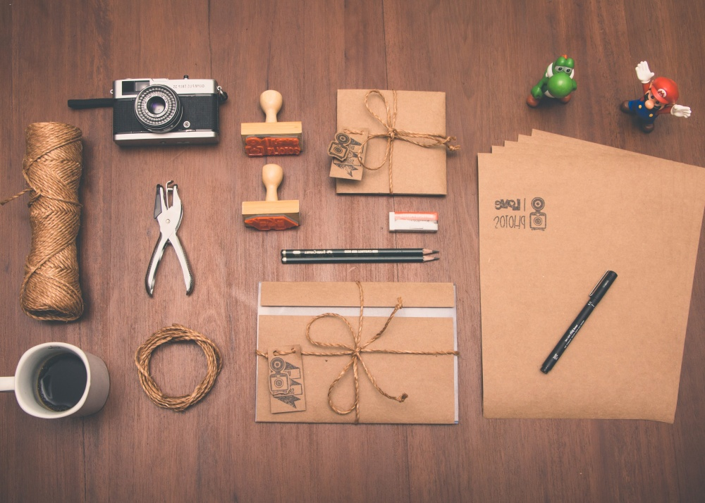 craft, material, coffee cup, paper, hand tool, toy, photo camera