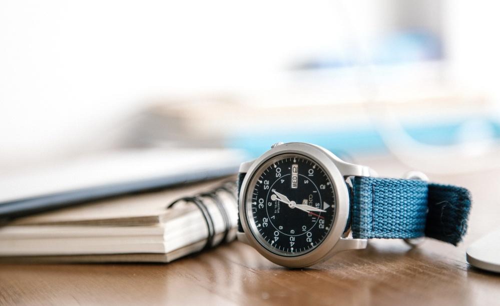 analog clock, wristwatch, book