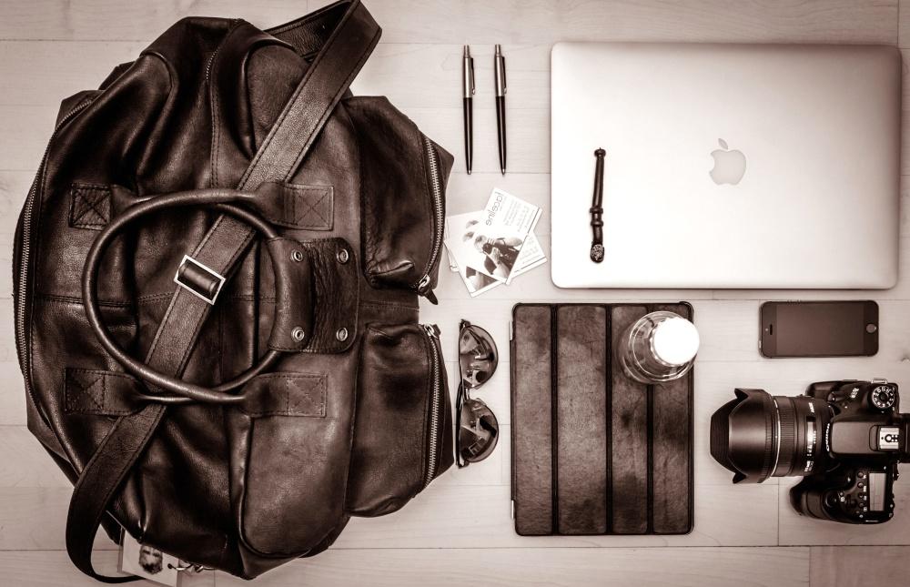 handbag, laptop computer, photo camera, pencil, object