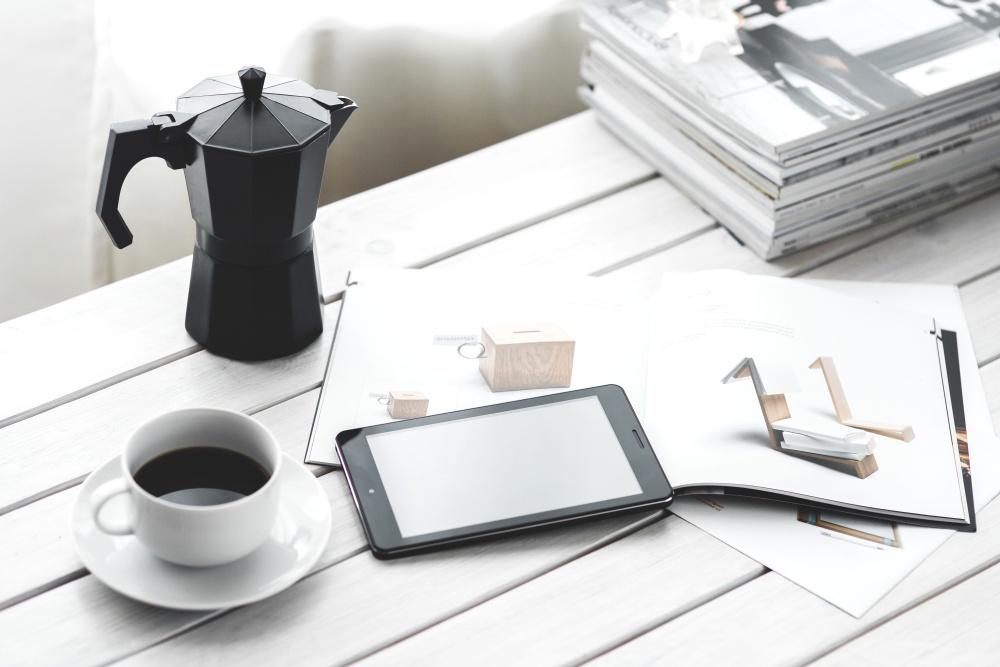coffee mug, mobile phone, desk, book, interior, design, magazine