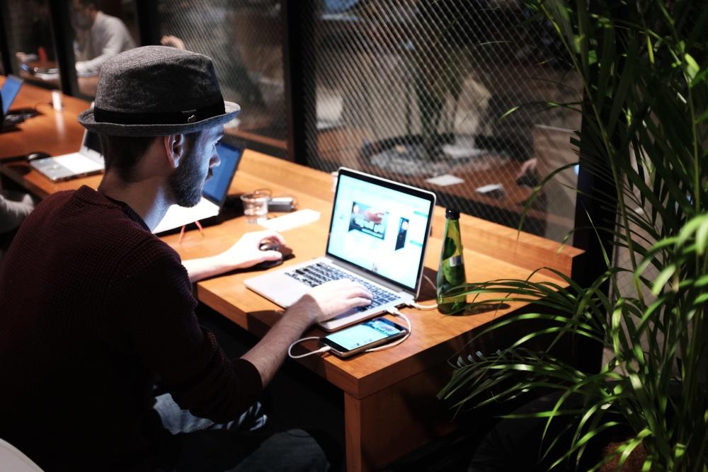 man, laptop computer, desk, work, hat, office, interior