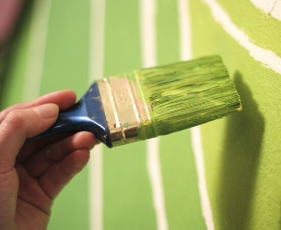 hand, hand tool, paintbrush, green, paint, wall