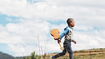 child, acoustic guitar, field, boy, fun, sky
