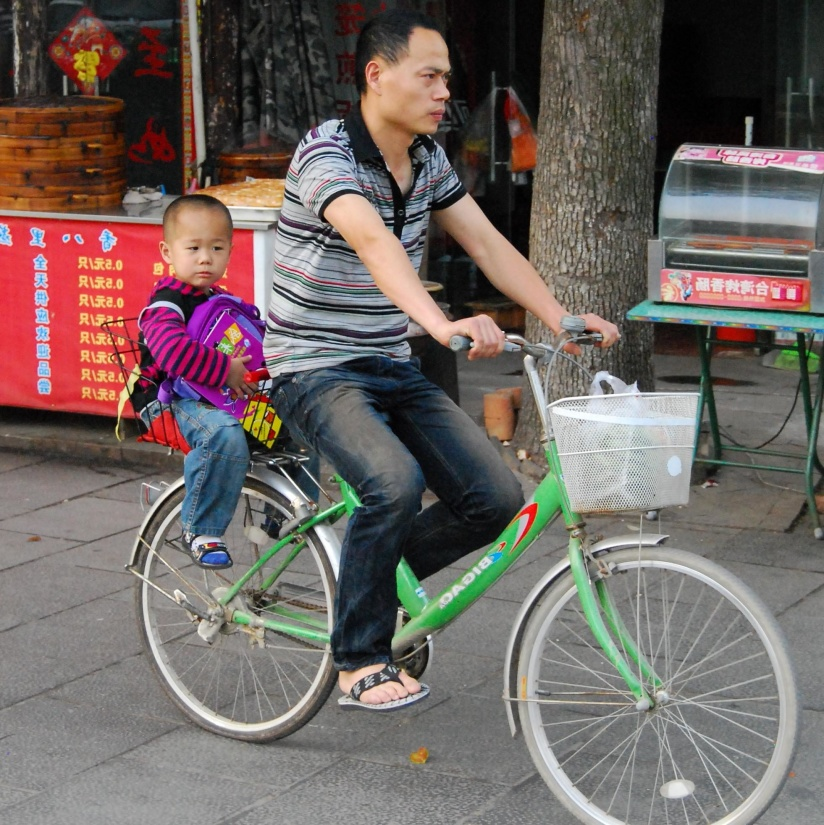 child, wheel, vehicle, people, street, cyclist, road, father, son, bicycle