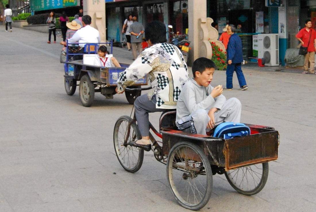 tricycle, moped, vehicle, street, people, wheel, road, city, cart, wagon