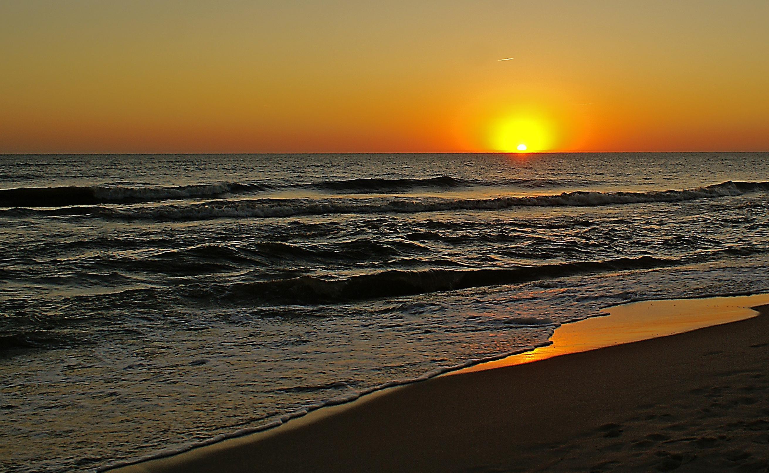 Foto Gratis Tramonto Spiaggia Sole Acqua Alba Mare Oceano