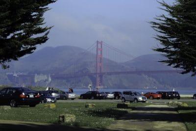 vehicle, bridge, sky, structure, outdoor, tree, grass