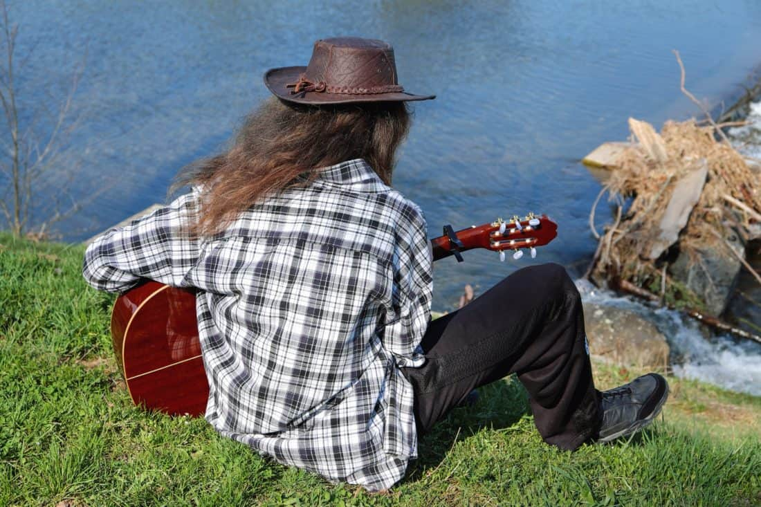 people, hat, man, outdoor, person, grass, guitar, music