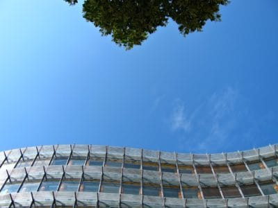 blue sky, building, facade, structure, outdoor, tree