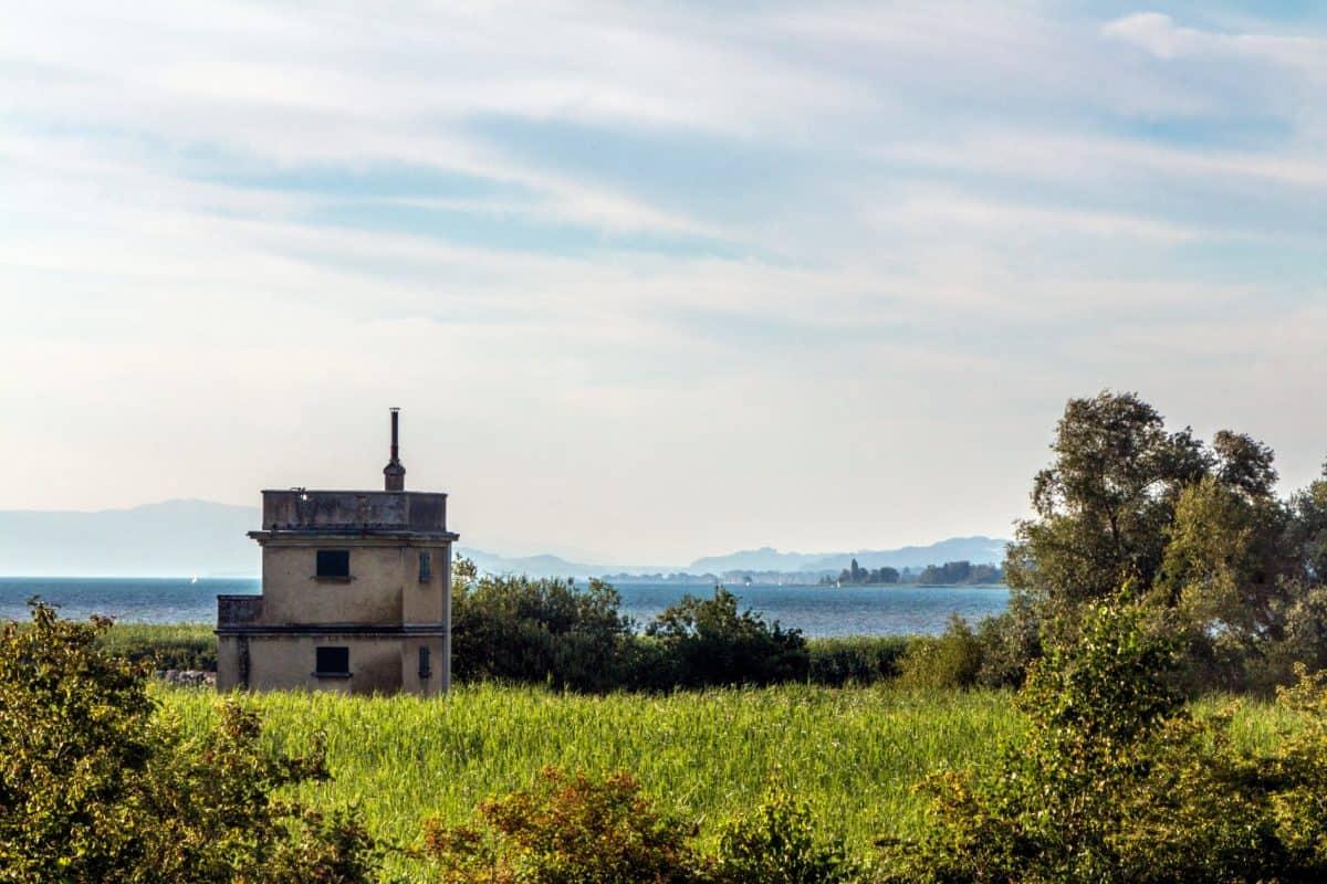 sky, landscape, field, outdoor, grass, tree, house, sea