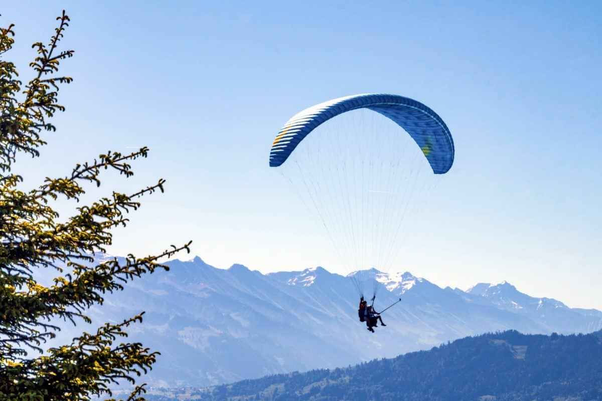blue sky, parachute, equipment, air, extreme sport, outdoor, tree, mountain