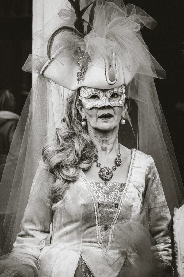 people, masquerade, costume, person, woman, person, face, monochrome
