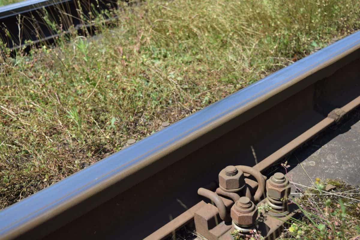 metal screw, iron, metal, railway, transport, grass