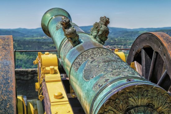 sky, outdoor, antique, cannon, fortification, sky, daylight, iron, metal