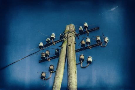electricity, blue sky, metal, wood, pole, ceramics, insulator