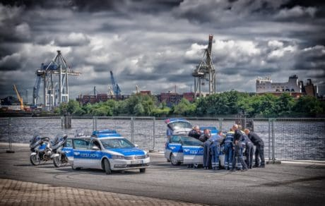 vehicle, sky, car, outdoor, road, river, police