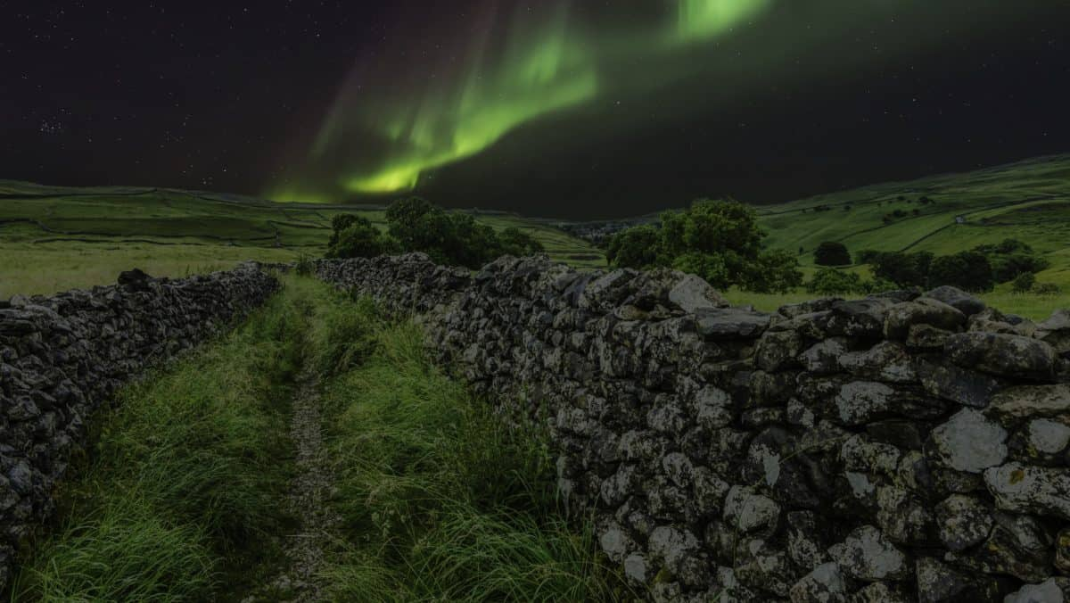night, polar light, landscape, grass, stone, fence, meadow