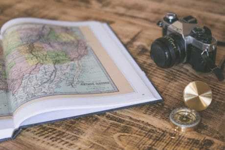 photo camera, compass, geography, book, map, paper, tabletop, floor, indoor