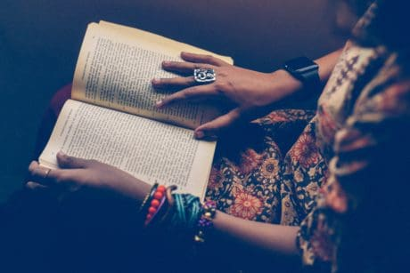 literature, book, jewelry, hand, text, textbook, shadow, woman, person