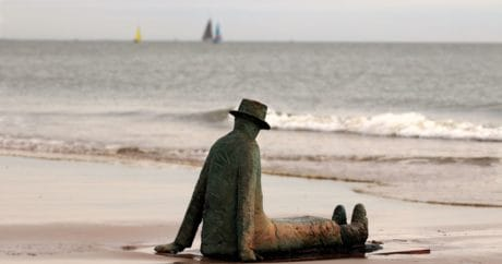 sculpture, bronze, metal, man, hat, coast, sea, sand, seashore, outdoor